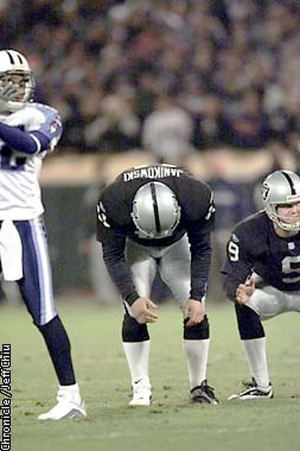 Sebastian Janikowski, slumps his shoulders after missing a second quarter field goal. The Oakland Raiders played the Tessessee Titans at Network Associates Coliseum in Oakland, Ca., on Saturday night, December 22, 2001. (JEFF CHIU/SAN FRANCISCO CHRONICLE) Photo: JEFF CHIU