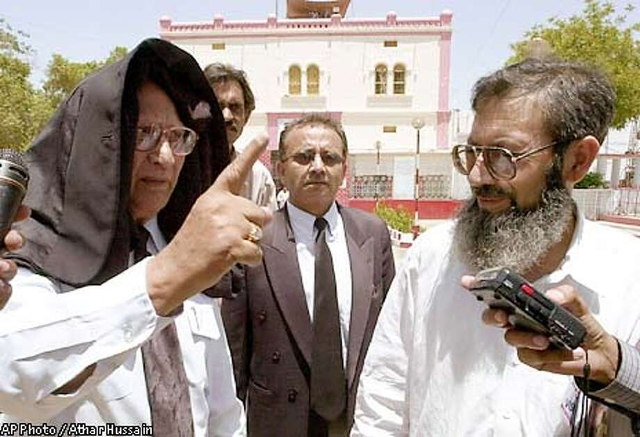 Abdul Waheed Katpur, left, defense lawyer of British-born Islamic militant Ahmed Omar Saeed Sheikh talks to press with Shiekh Ahmed Saeed, right, father of Ahmed, Tuesday, May 14, 2002 in Hyderabad, 100 kilometers(60 miles) from Karachi, Pakistan outside the Central Jail. Trial for the murder of Wall Street Journal reporter Daniel Pearl was shifted to Hyderabad due to security reasons.(AP Photo/Athar Hussain) Photo: ATHAR HUSSAIN
