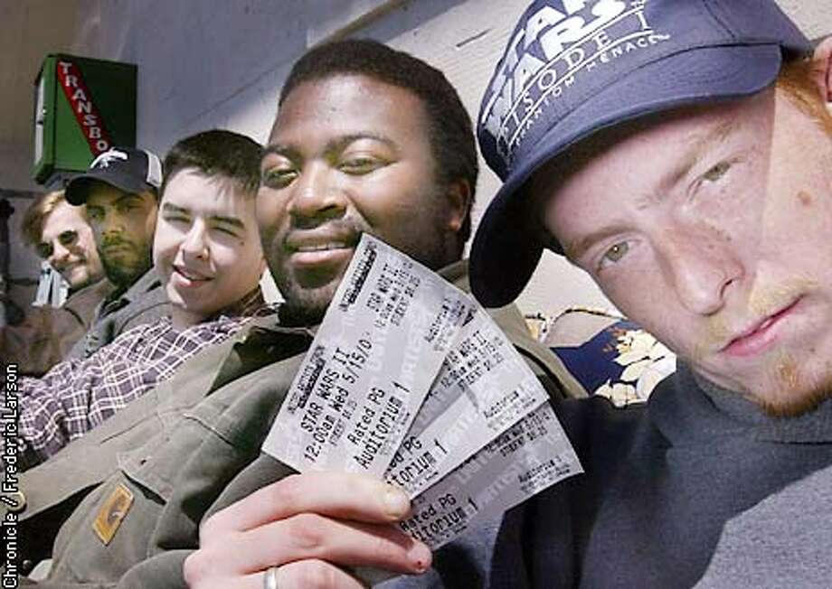 """: Starwar fans M.C McGee (far right to left) Terrill Couther, Brandon Wallace, A.J Napper and David T. Claude are the lucky ones with tickets and head of the line for the latest Starwars movie, Episode II, """"Attack of the Clones"""" at the Coronet theater in SF. Chronicle photo by Frederic Larson Photo: FREDERIC LARSON"""