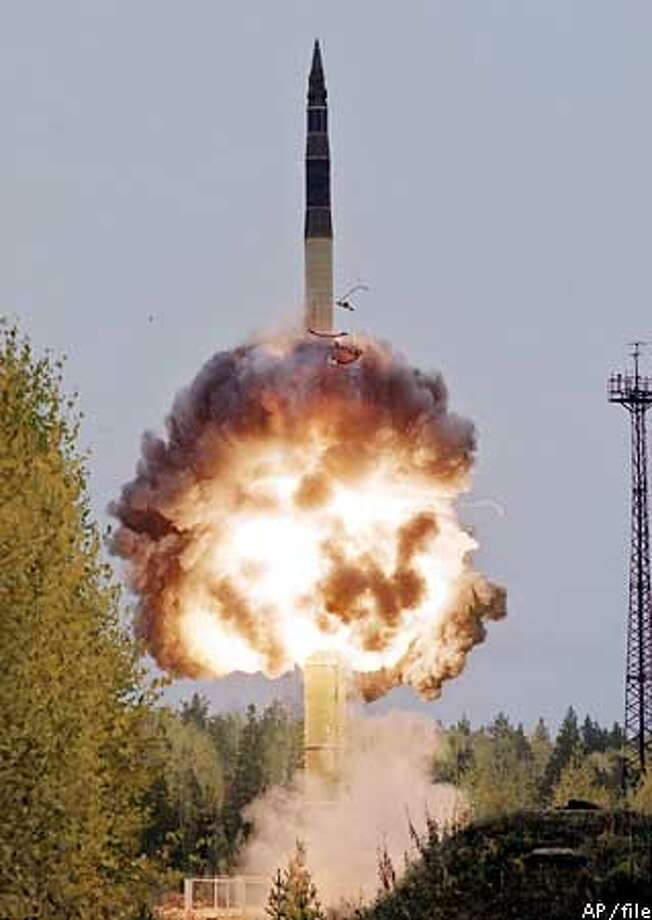 A Topol-M intercontinental ballistic missile is launched from the northern Plesetsk cosmodrome in this October 1999 photo. Deployment of the new, single-warhead Topol-M missiles has lagged far behind the planned numbers of 30-40 a year, with just 26 going on combat duty during the last three years due to the military's lack of funds. (AP Photo) Photo: STR