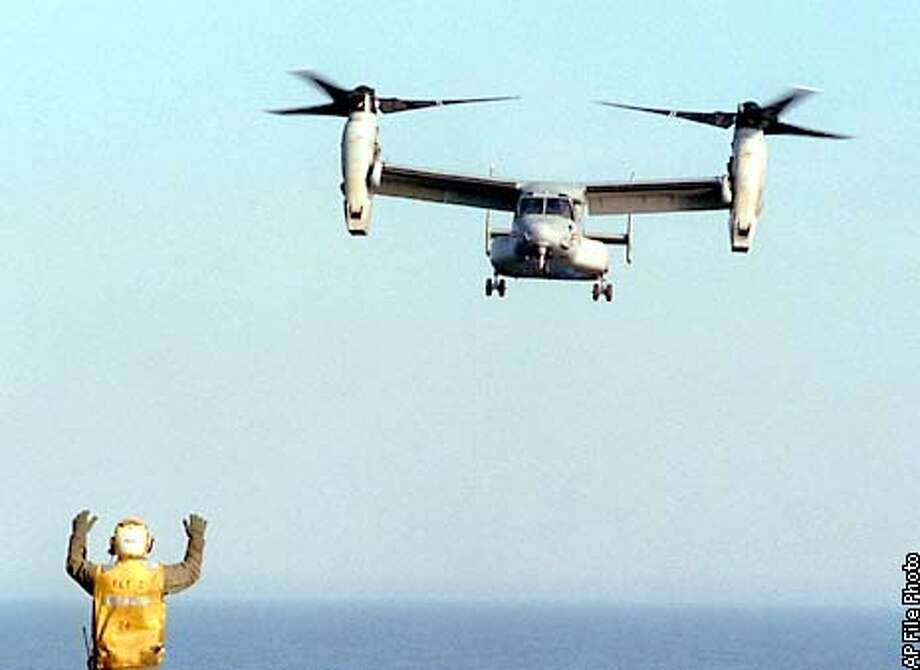 FILE--A V-22 Osprey makes a landing approach to the USS Saipan, in this Jan. 28, 1999, file photo. The Pentagon announced Friday, Dec. 21, 2001, it will resume testing of the V-22 Osprey, which has been grounded since last year following two crashes that killed 23 Marines. Flight tests on the helicopter-like aircraft are scheduled to resume in April 2002. (AP Photo/The Virginian-Pilot, D. Kevin Elliott, File) Photo: D. KEVIN ELLIOTT
