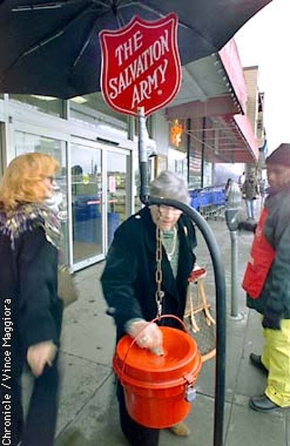 Salvation Armys pot at Tower Market , gay groups are putting fake bills into the bell ringers pots because of Salvation Armys policies don't include domestic partners benefits  by Vince Maggiora Photo: VINCE MAGGIORA