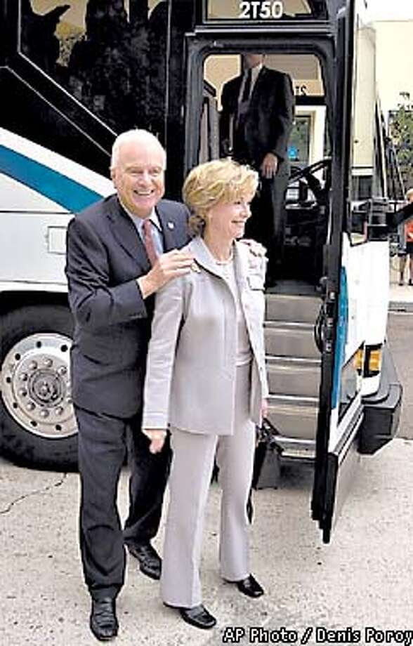 Former Los Angeles Mayor Richard Riordan greets campaign workers with his wife Nancy Riordan as he arrives at High Tech High School, Tuesday, Nov. 6, 2001, in San Diego. Riordan officially declared his candidacy for governor of the state of California on Tuesday. His visit to the school was the first stop on a campaign swing through San Diego. (AP Photo/Denis Poroy) Photo: DENIS POROY