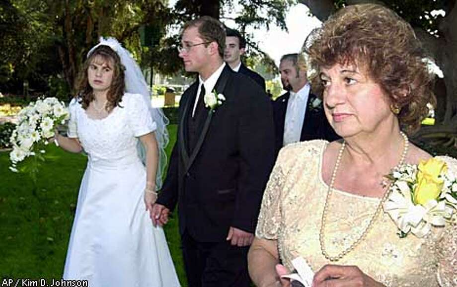 Ellen Mariani, right, attended the wedding of her daughter on Sept. 15. Mariani's husband died when his plane was hijacked Sept. 11. Associated Press photo by Kim D. Johnson