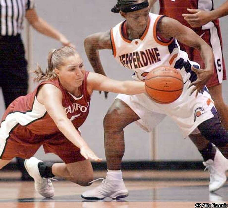 Stanford's Kelley Suminski, left, steals the ball from Pepperdine's Tamara McDonald, right, in the first half Friday, Nov. 30, 2001, at the Firestone Fieldhouse in Malibu, Calif. (AP Photo/Ric Francis) Photo: RIC FRANCIS