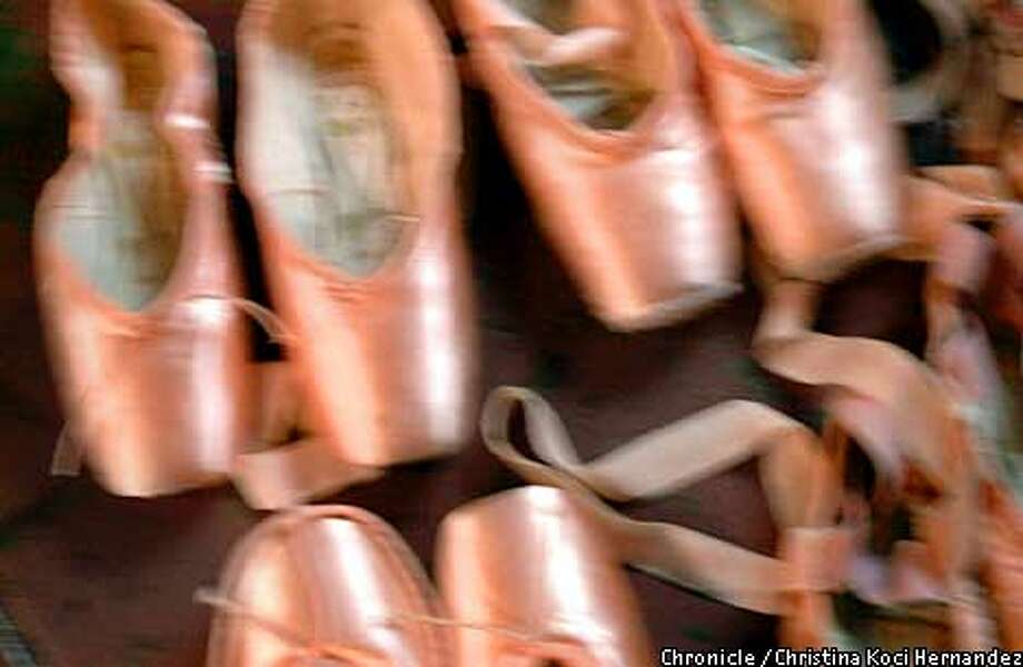 EBNUTCRACK-C-06DEC01-EF-CKH  CHRISTINA KOCI HERNANDEZ/CHRONICLE  Toe shoes wait to have ribbons sewn onto them at a studio rehearsal for the Nutcracker, by the Oakland Ballet, at Alice Arts studios in Oakland. Photo: CHRISTINA KOCI HERNANDEZ
