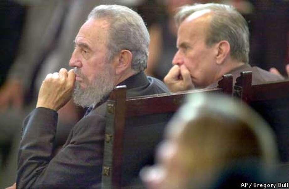 Cuban President Fidel Castro, left, listens to former President Jimmy Carter's speech. Associated Press photo by Gregory Bull