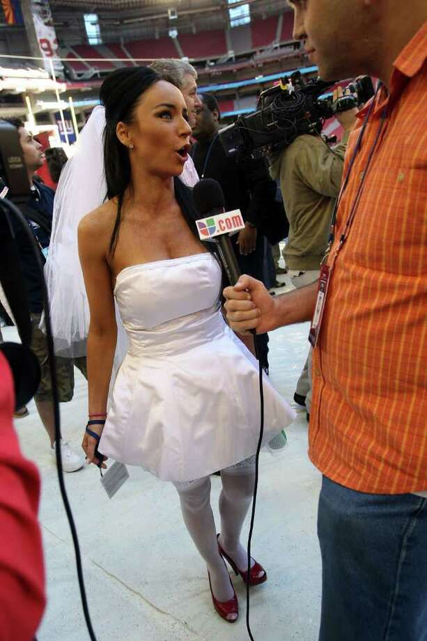 "25. A proposal to Tom Brady – Super Bowl XLII: Media Day is full of crazy stunts. Ines Gomez Mont's might top the list. The TV Azteca reporter, wearing a wedding dress, interrupted media day and proposed to Patriots quarterback Tom Brady. ""Marry me now, Tom! Say, yes! I'm the real Mrs. Brady."" Needless to say, he passed. Photo: Scott Halleran, Getty Images / 2008 Getty Images"