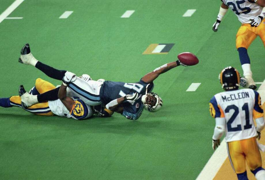 7. The Tackle – Super Bowl XXXIV: With the Rams leading 23-16, Steve McNair drove Tennessee to the St. Louis 10 with six seconds left and, on the last play, found Kevin Dyson on a slant pass at the St. Louis 3. Dyson lunged for the end zone but was stopped about a half yard short by Rams linebacker Mike Jones. Photo: Tom Hauck, Getty Images / 2000 Getty Images