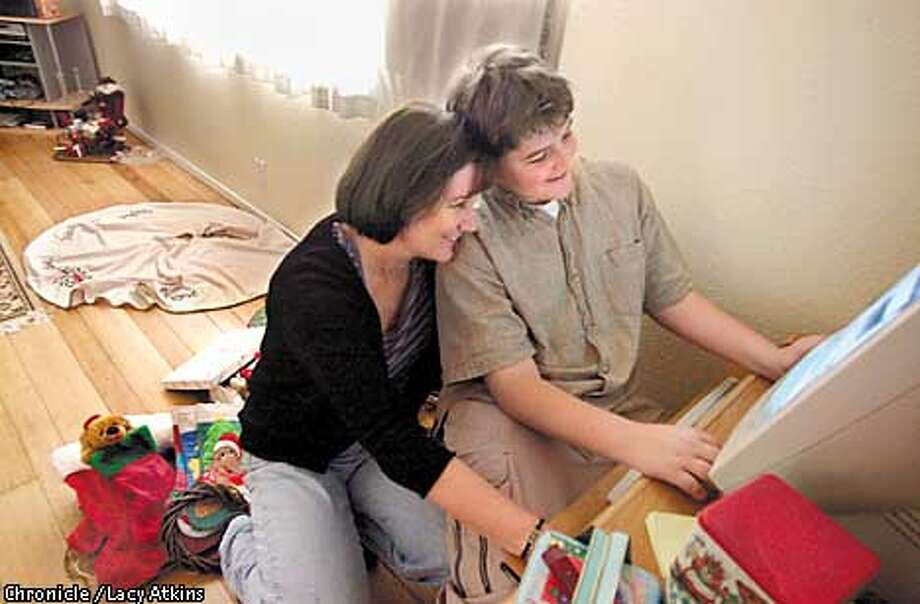 Staff Sergent Terry Young and her son Kelley 12 years old, look over things on the computer, as they prepare to decorate their home in Napa. Kelley is the youngest of Terrys three children and is having the hardest time with her being gone as much as she is on duty with the National guard.  Photo By Lacy Atkins/SanFrancisco Chronicle Photo: Lacy Atkins
