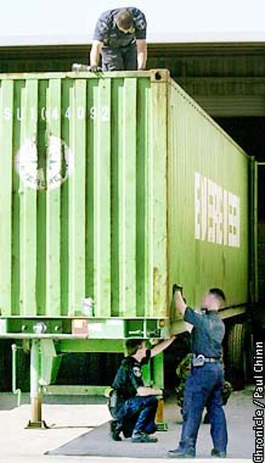 U.S. Customs agents inspected shipping containers from top-to-bottom which have arrived via cargo ships at the Port of Oakland.  PAUL CHINN/S.F. CHRONICLE Photo: PAUL CHINN