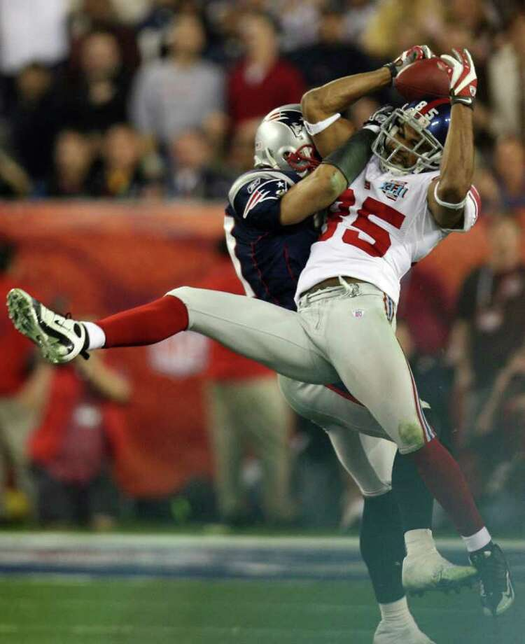 3. Tyree's amazing helmet catch – Super Bowl XLII: Trailing 14-10 and facing a third-and-5 at his own 44 with 1:15 left, Eli Manning evaded a blitz and completed a pass to a tightly covered David Tyree, who trapped the ball between one hand and his helmet before gaining full possession at the Patriots' 25. Two plays later, the Giants scored the winning touchdown, preventing the Pats from finishing 18-0.    Photo: GABRIEL BOUYS, AFP/Getty Images / 2008 AFP