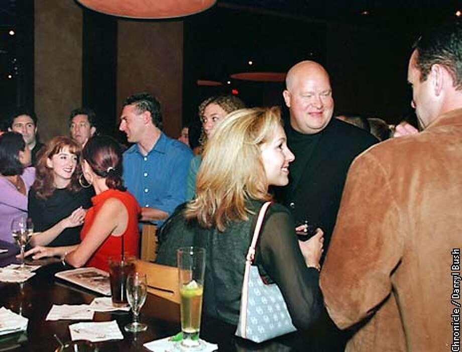 People mingle and talk at the bar at P. F. Chang's China Bistro in Walnut Creek. Chronicle Photo by Darryl Bush Photo: Darryl Bush
