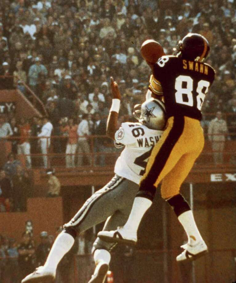 12. The Super Bowl's greatest catch – Super Bowl X:En route to winning game MVP honors, the Steelers' Lynn Swann made arguably the greatest catch in Super Bowl history when he leaped high over the Cowboys' Ron Washington to get his hands on a Terry Bradshaw pass. Although he bobbled the ball briefly, he maintained possession for a 53-yard gain. Photo: AP