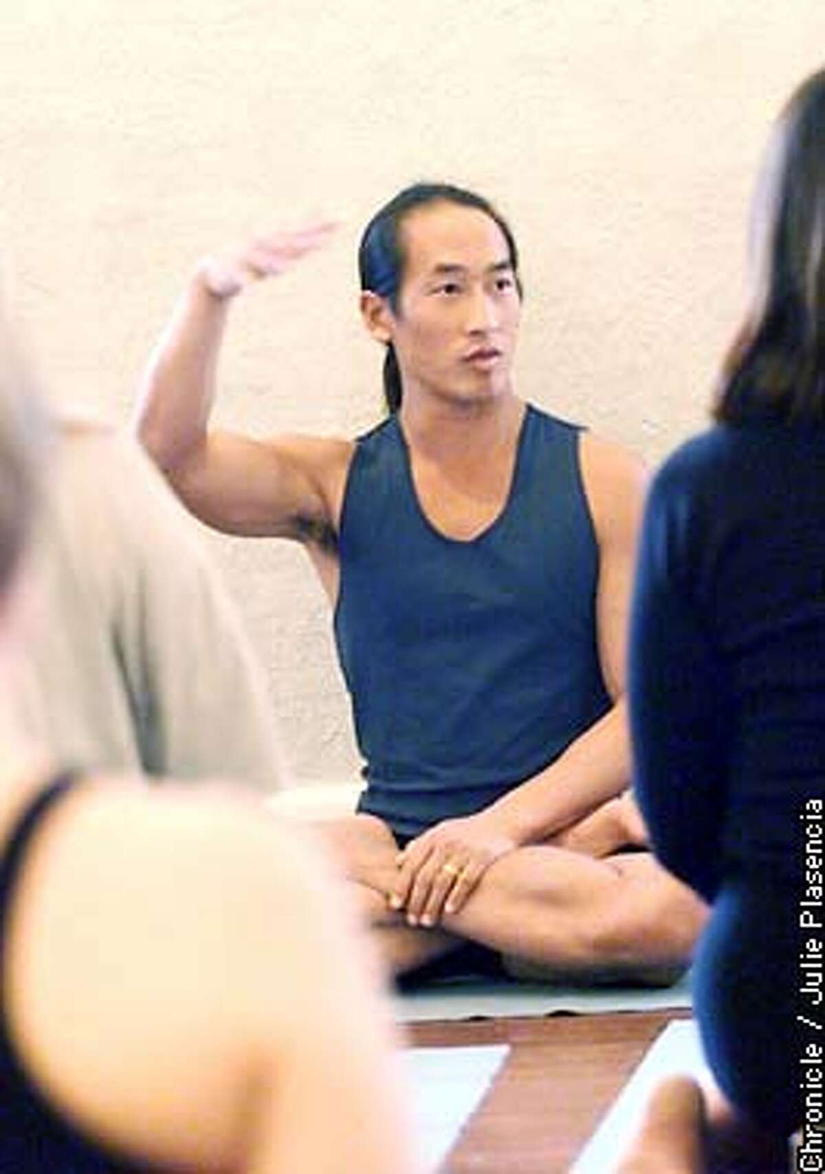 World famous yoga instructor Rodney Yee of Oakland speaks to a packed beginging yoga class in the Piedmont yoga studios in Oakland. (JULIE PLASENCIA/SFC)