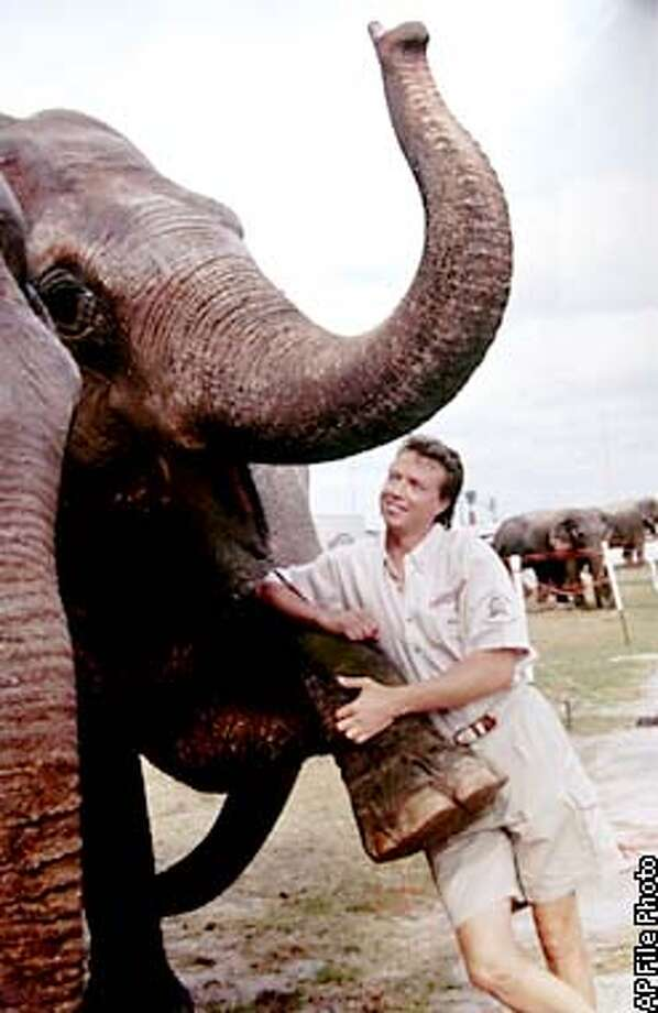 FILE--Undated file photo of Ringling Bros. and Barnum and Bailey Circus elephant trainer Mark Oliver Gebel with the elephant Asia. Gebel is going on trial in a San Jose, Calif., courtroom Monday, Dec. 17, 2001, for allegedly using a hooked stick to open up a bloody wound on Asia's left front leg in an incident on Aug. 26, 2001 while the circus was in San Jose. (AP Photo/Ringling Bros. and Barnum & Bailey Circus)