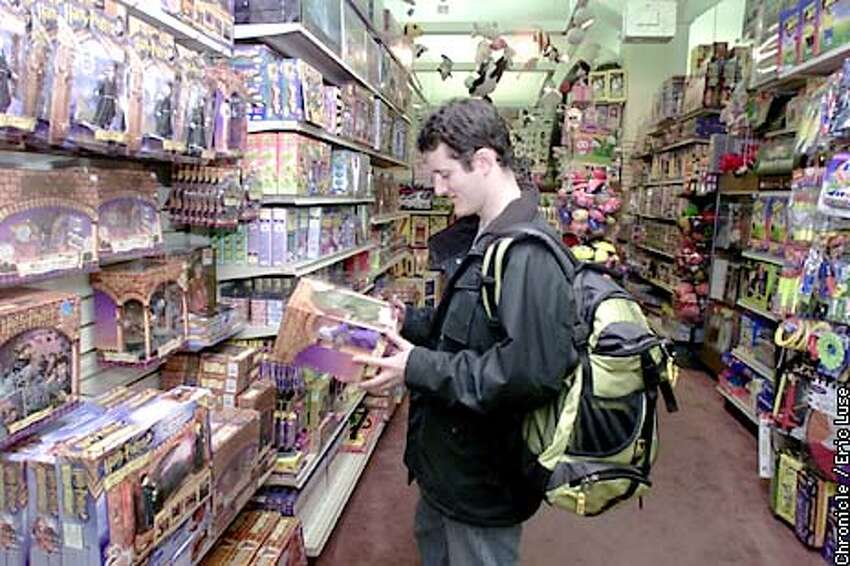 Barry Roche looks over Harry Potter toys at Jeffrey's Toys in San Francisco as a Christmas gift for his girlfriend. BY ERIC LUSE/THE CHRONICLE