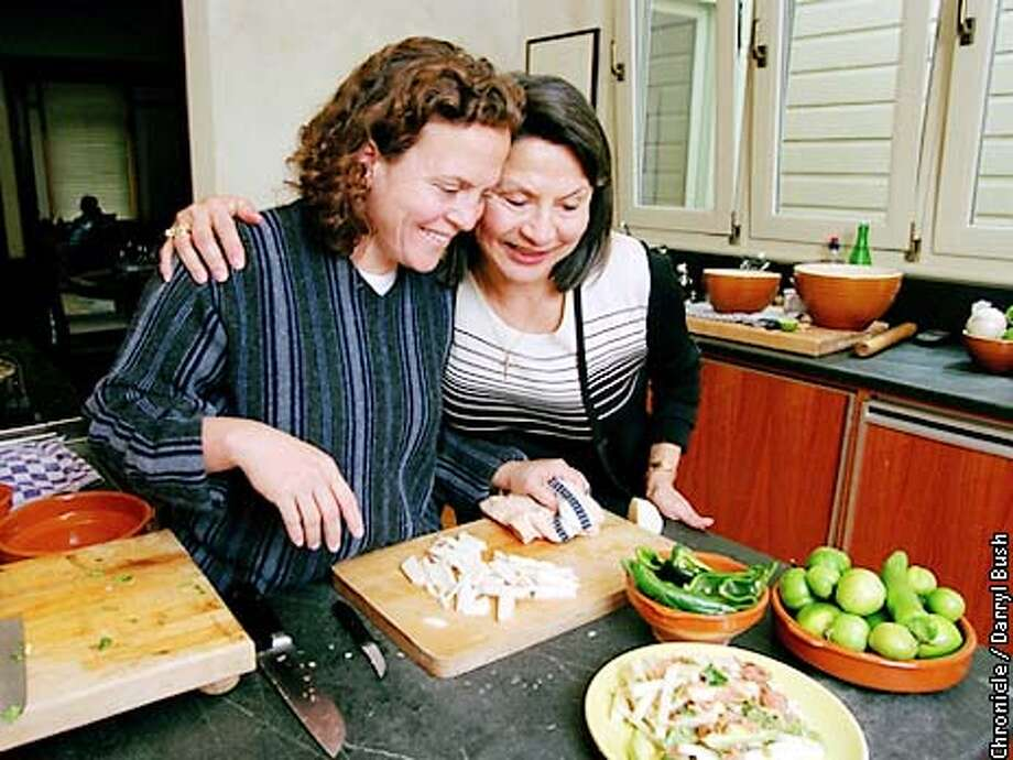 Chef Traci Desjardin, left, hugs her mom as the make salad together in Traci's home kitchen in San Francisco. Chronicle Photo by Darryl Bush Photo: Darryl Bush