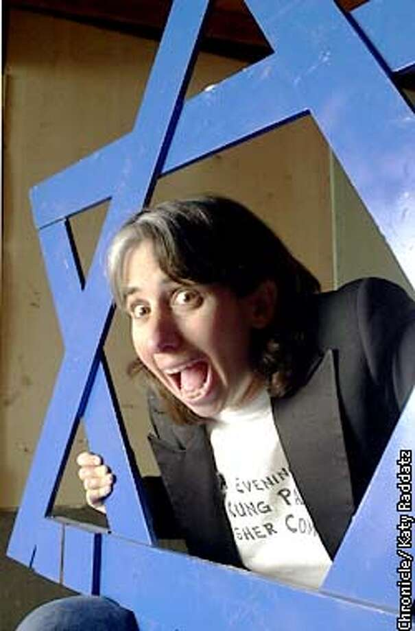 Photo by Katy Raddatz--The Chronicle  Lisa Geduldig is a comedienne and a producer; she is founder and producer of the annual Kung Pao Kosher Comedy show, wherein Jewish humor is performed in a Chinese reataurant for folks who want a break from Christmas. Lisa is shown with the big wooden Star of David menorah she uses for the show. Photo: KATY RADDATZ