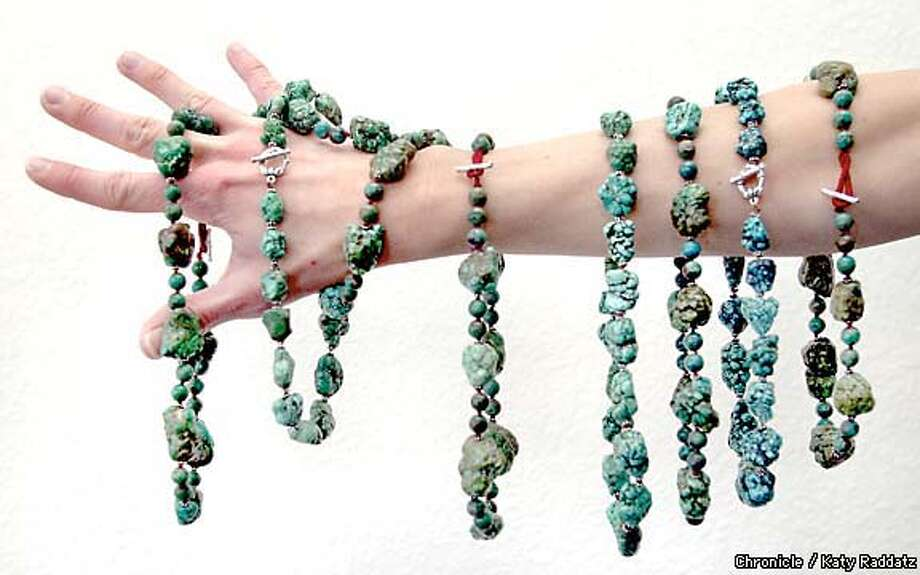 Arm yourself: Fuego Six designer Amy Valenzuela shows off chunky turquoise beaded necklaces. Chronicle photo by Katy Raddatz