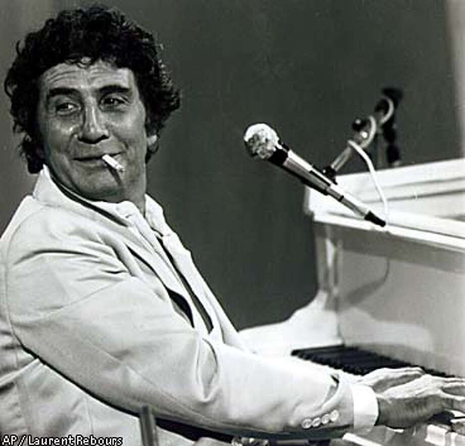 "Gilbert Becaud was part of the ""la chanson francaise"" movement. Associated Press photo by Laurent Rebours"