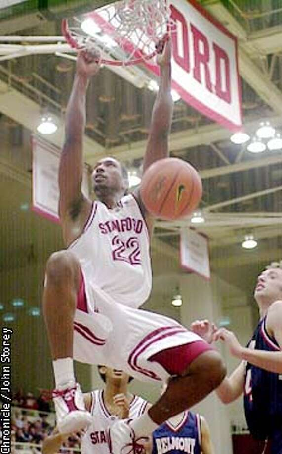 STANFORD-C-18DEC01-SP-JRS-Stanford vs. the Belmont Bruins at Maples Pavillion. Justin Davis dunks in the first half. Chronicle photo by John Storey. Photo: John Storey