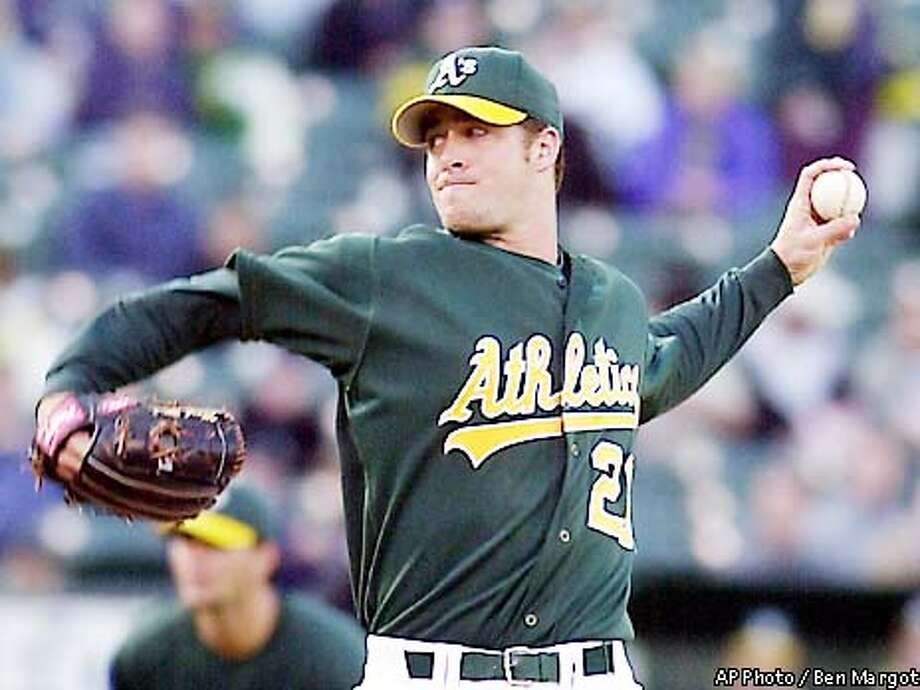 Oakland Athletics' Mark Mulder winds up against the Toronto Blue Jays in the first inning Friday, May 10, 2002, in Oakland, Calif. Mulder returned from the disabled list, making his first start since April 15. (AP Photo/Ben Margot) Photo: BEN MARGOT