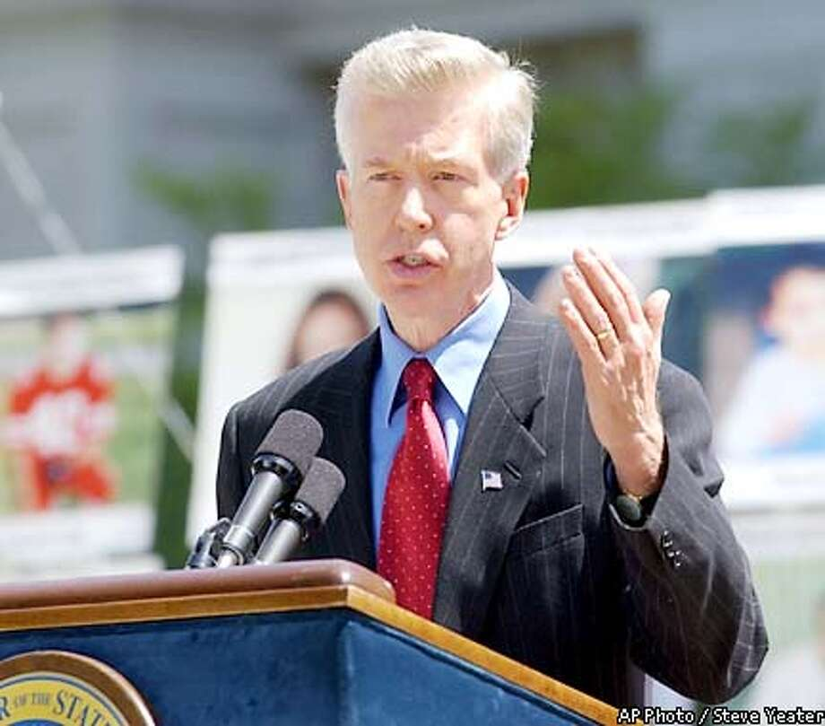 Gov. Gray Davis speaks to victims of crimes and their families gathered at the Capitol in Sacramento, Calif., on Tuesday, April 23, 2002, to demand greater rights and attention. When asked about the at an event later in the day Davis said that he thinks he can still balance the it without raising taxes. (AP Photo/Steve Yeater) Photo: STEVE YEATER