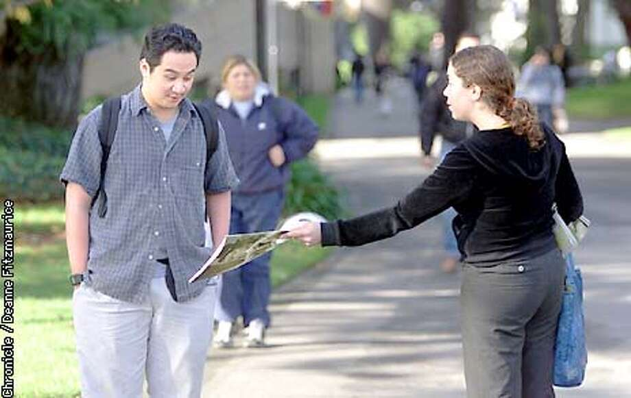 Glen Madrona looks with surprise at the dildo picture on the cover of the current issue of Express Magazine, a SFSU campus publication, distributed by Lilmarie Birr, Photo Editor. This issue had been pulled off the racks.  CHRONICLE PHOTO BY DEANNE FITZMAURICE Photo: DEANNE FITZMAURICE