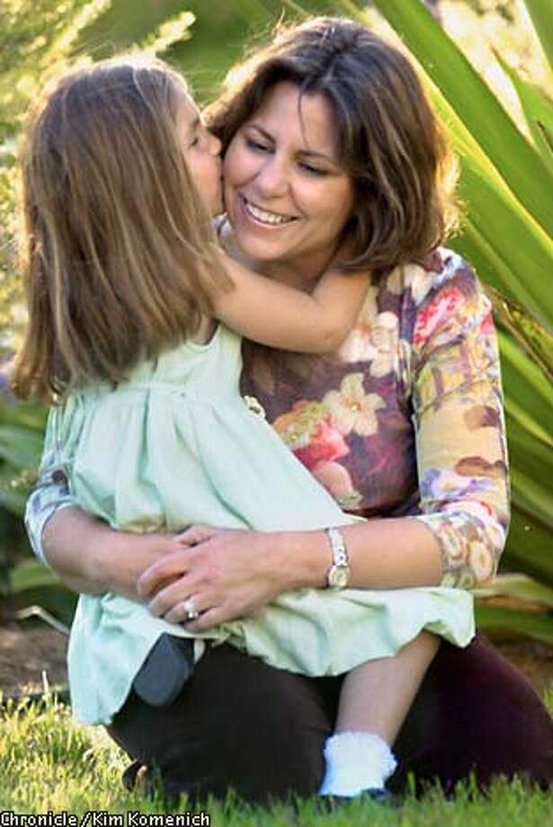 Michelle Deen plays with daughter Alisa, 5, outside their Santa Barbara home. Deen wrote a book about the challenges she faced during Alisa's first year.  CHRONICLE PHOTO BY KIM KOMENICH Photo: KIM KOMENICH