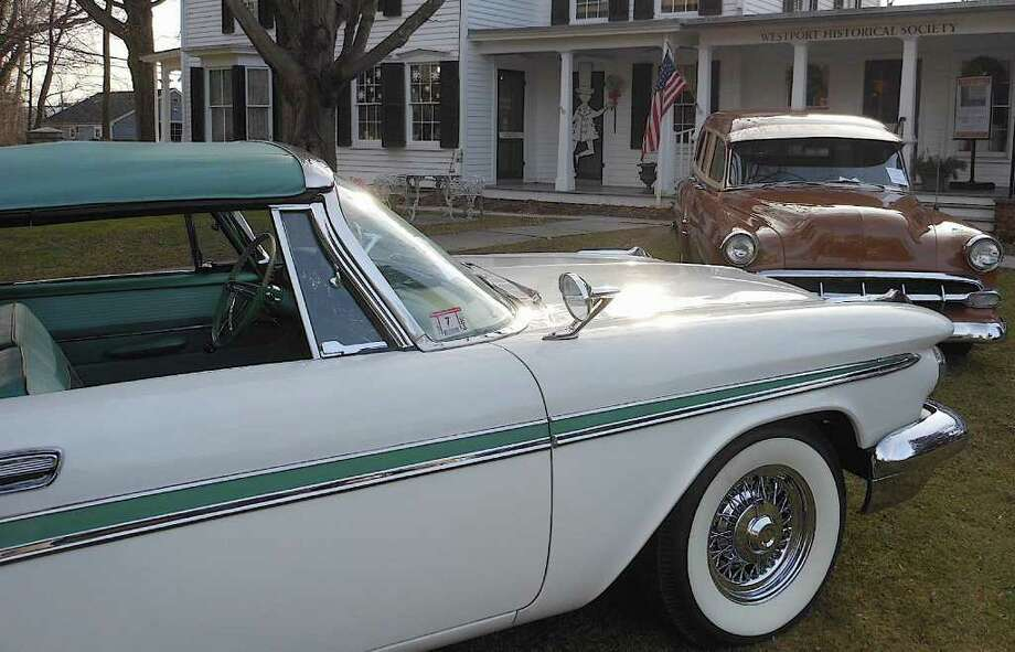 "A 1959 Desoto and 1954 Chevrolet, on loan from Dragone Classic Motorcars, set the stage Sunday at the  Westport Historical Society for its new exhibit ""Next Stop: Westport,"" showcasing 1950s TV and film writers. Photo: Mike Lauterborn / Westport News contributed"
