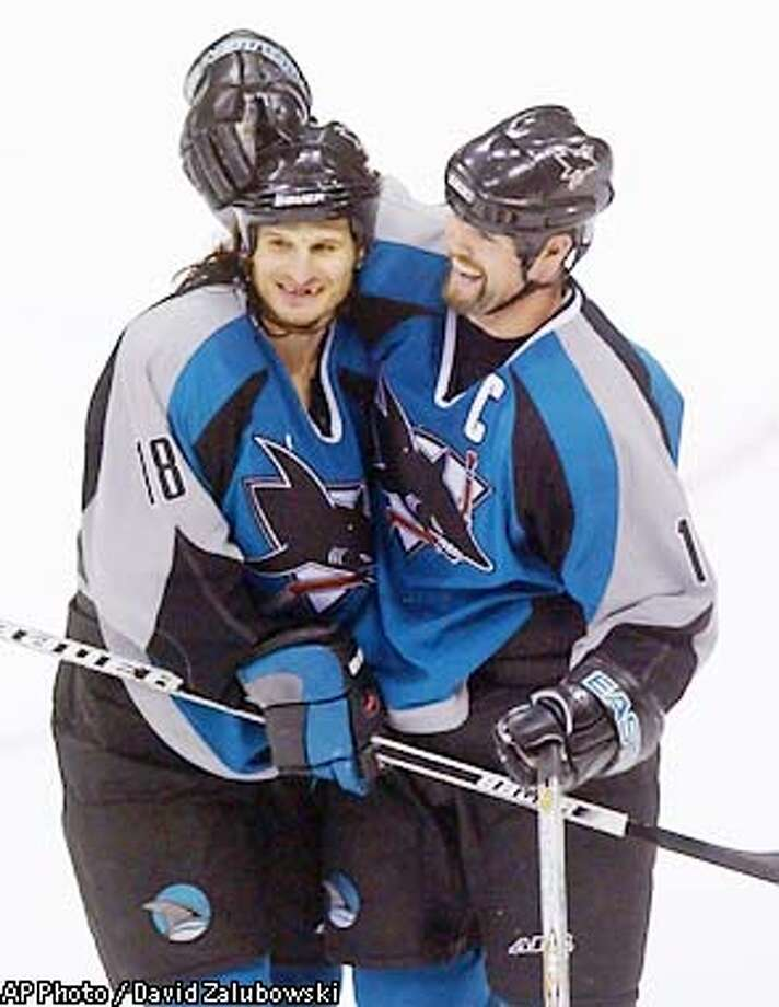 San Jose Sharks center Mike Ricci, left, celebrates with right winger Owen Nolan after the Sharks' 5-3 victory over the Colorado Avalanche in Game 5 of the the NHL Western Conference second-round playoff series Saturday, May 11, 2002, in Denver. (AP Photo/David Zalubowski) Photo: DAVID ZALUBOWSKI