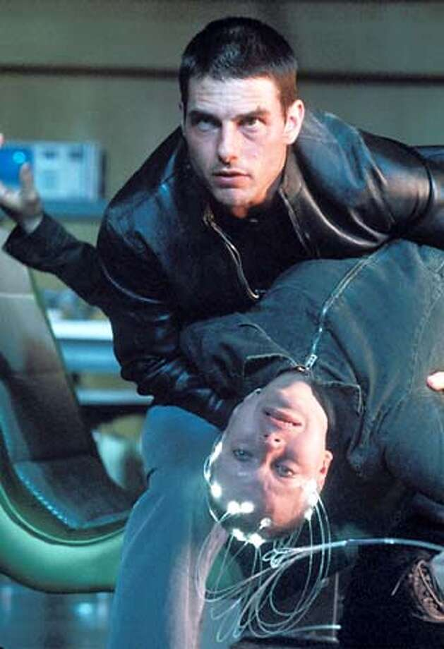 """Tom Cruise stars with Samantha Morton in Steven Spielberg's futuristic cop story, """"The Minority Report."""""""