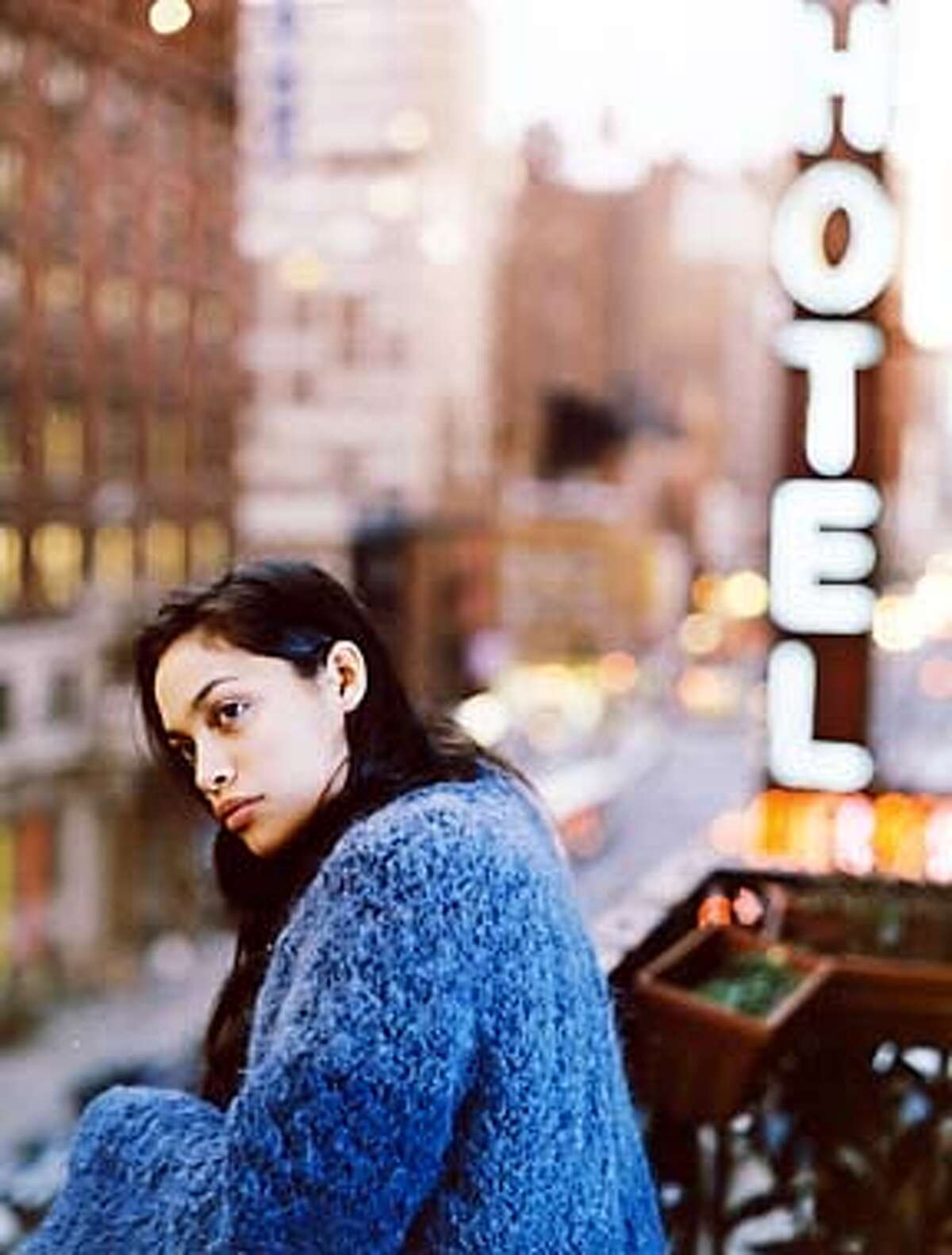 THIS IS A HANDOUT IMAGE. PLEASE VERIFY RIGHTS. Rosario Dawson as Audrey in CHELSEA WALLS.