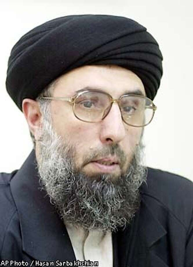 Gulbuddin Hekmatyar, leader of the Afghanistan Islamic Party, answers journalists questions about the joint U.S.-British attacks in Afghanistan, which he condemned, in Tehran, Iran, Tuesday Oct. 9, 2001. (AP Photo/Hasan Sarbakhshian) Photo: HASAN SARBAKHSHIAN