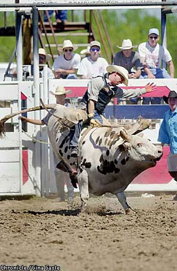 Livermore's Justin Andrade earns his spurs at the 51st Annual Oakdale Saddle Club PRCA Rodeo. Andrade, 29, is enjoying the best season of his career; the Professional Rodeo Cowboys Association ranks him third in earnings so far. Chronicle photo by Gina Gayle