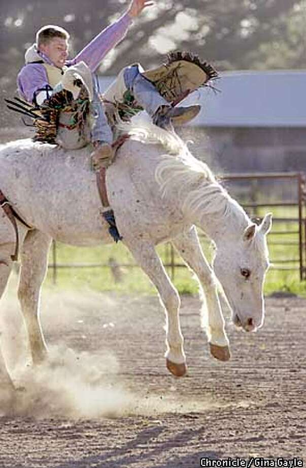 Bareback bronco rider Alex Meroshnekoff practices at a ranch in Cotati. Alex broke his back at a rodeo three years ago and now has two steel rods in his spine hooked to his rib cage. Photo by Gina Gayle/The SF Chronicle. Photo: GINA GAYLE