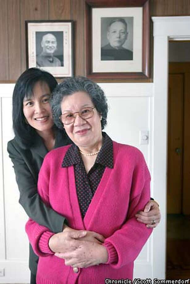 Dinah Yee Tom hugs her mother, Soo Ching Wong Yee in front of family portraits of ,.,.,.,.,.,.,.,.,.,., in their San Francisco home. (SF CHRONICLE PHOTO BY SCOTT SOMMERDORF) Photo: SCOTT SOMMERDORF