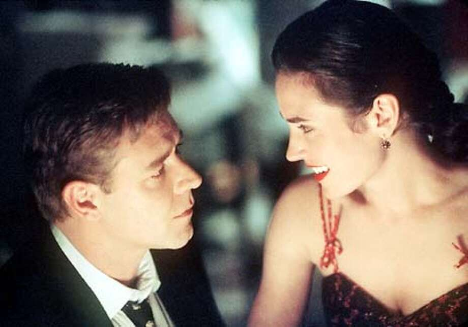 """FILE--Russell Crowe and Jennifer Connelly, seen here in """"A Beautiful Mind,"""" received best actor and actress nominations from the Screen Actors Guild awards for their roles in the film. """"A Beautiful Mind"""" also received the SAG's nomination for best ensemble performance, the guild's version of best picture. The nominations were announced Tuesday Jan. 2, 2002, in West Hollywood, Calif. The winners will be named March 10 during a Los Angeles show. (AP Photo/Eli Reed, Universal Studios), Also ran3/19/02 Photo: ELI REED"""