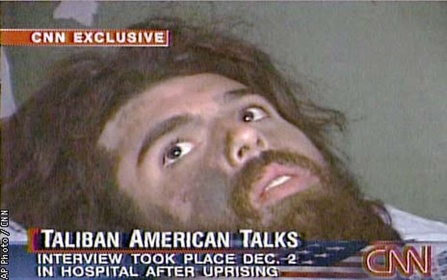 In this image from television broadcast Wednesday, Dec. 19, 2001, fighter John Walker Lindh is seen during an interview soon after his capture. According to CNN, the interview took place Dec. 2, 2001. (AP Photos/CNN)