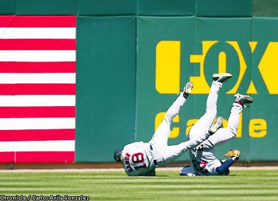 Boston Red Sox's Brian Daubach, right, and Johnny Damon, left, go heels over heads after they collide in the bottom of the ninth inning as the Sox finish off the Oakland Athletics 5-1 at Network Associates' Coliseum on Oakland, Ca., on Thursday, May 9, 2002.  (CARLOS AVILA GONZALEZ/SAN FRANCISCO CHRONICLE) Photo: CARLOS AVILA GONZALEZ