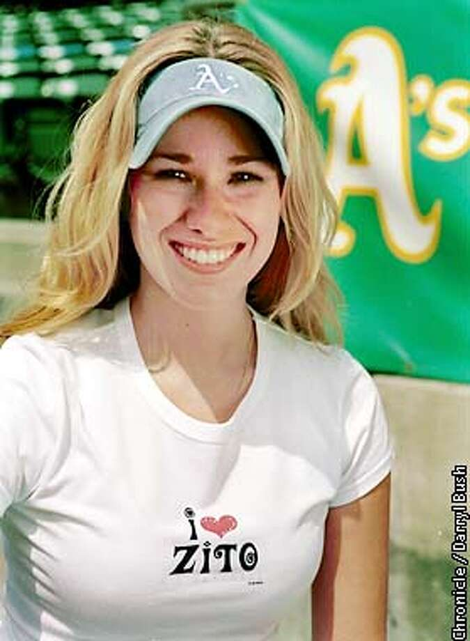 Leanna Hill, retail operations coordinater of the Oakland A's, wears the tee shirt she came up with the concept for, that refers to A's pitcher Barry Zito at the Oakland Coliseum. Chronicle Photo by Darryl Bush Photo: Darryl Bush