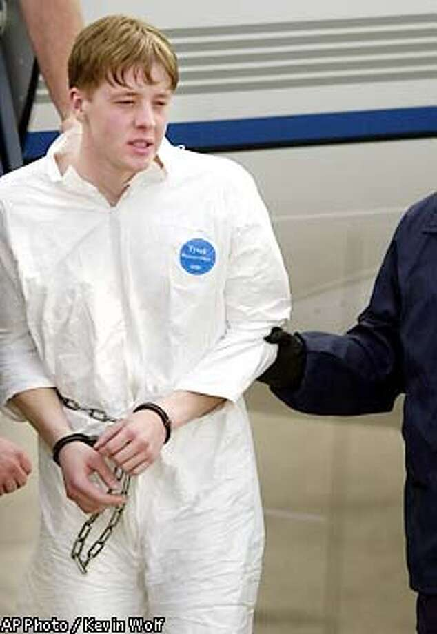 U.S. Marshals lead mailbox bombing suspect Luke Helder to an awaiting van at the Eastern Iowa Airport to transport him to the Federal Courthouse in Cedar Rapids, Iowa, Friday, May 10, 2002. Helder, is suspected in a series of mailbox bombings. (AP Photo/The Gazette, Kevin Wolf) Photo: KEVIN WOLF
