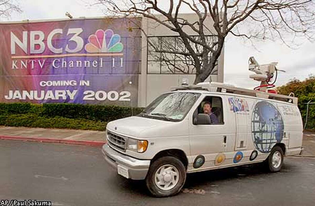 A KNTV Channel 11 photographers van leaves the station in San Jose, Calif., Monday morning, Dec. 17, 2001 with a huge banner on the front side of the building. NBC announced Monday it is buying the San Jose based KNTV for $230 million from Granite Broadcasting Corp., giving the network an owned-and-operated station in the San Francisco Bay Area. (AP Photo/Paul Sakuma)