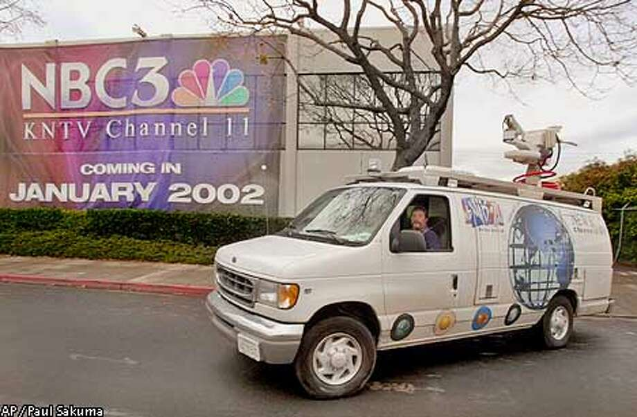 A KNTV Channel 11 photographers van leaves the station in San Jose, Calif., Monday morning, Dec. 17, 2001 with a huge banner on the front side of the building. NBC announced Monday it is buying the San Jose based KNTV for $230 million from Granite Broadcasting Corp., giving the network an owned-and-operated station in the San Francisco Bay Area. (AP Photo/Paul Sakuma) Photo: PAUL SAKUMA