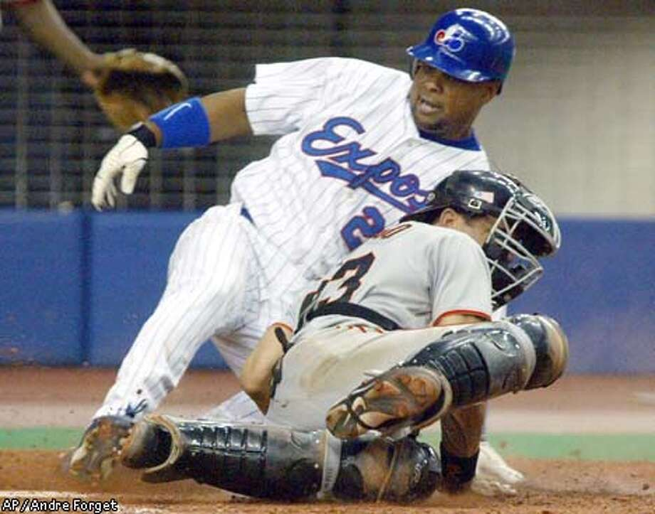 Giants catcher Benito Santiago takes Tsuyoshi Shinjo's remarkable throw and tags out Troy O'Leary of the Expos in the eighth inning. Associated Press photo by Andre Forget