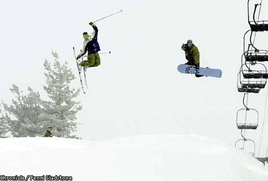 Mike Schimke age 19 freestyle skiier, & Terry Nelson, snowboarder age 20 at Bear Valley winter resort. The resort now has reached a 50/50 split on skiers and snowboard users. It has developed extensive terrain parks to serve the boarders and freestyle skiers. CHRONICLE PHOTOGRAPHY BY PENNI GLADSTONE Photo: PENNI GLADSTONE