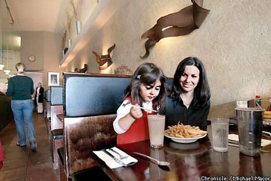 Polkers lunchtime regulars Flora, 4, and Alexandra Fouladi live near the Polk Street restaurant. Chronicle photo by Michael Macor
