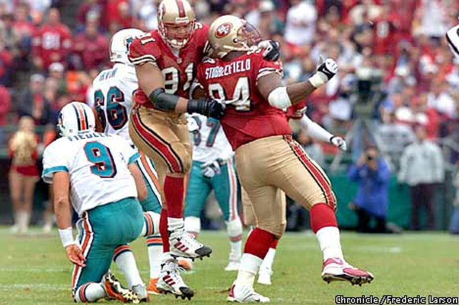 San Francisco 49ers vs. Miami Dolphins. Second quarter action. Terrell Owens #81 and Dana Stubblefield #84, celebrating.  Chronicle Photo by Frederic Larson Photo: FREDERIC LARSON