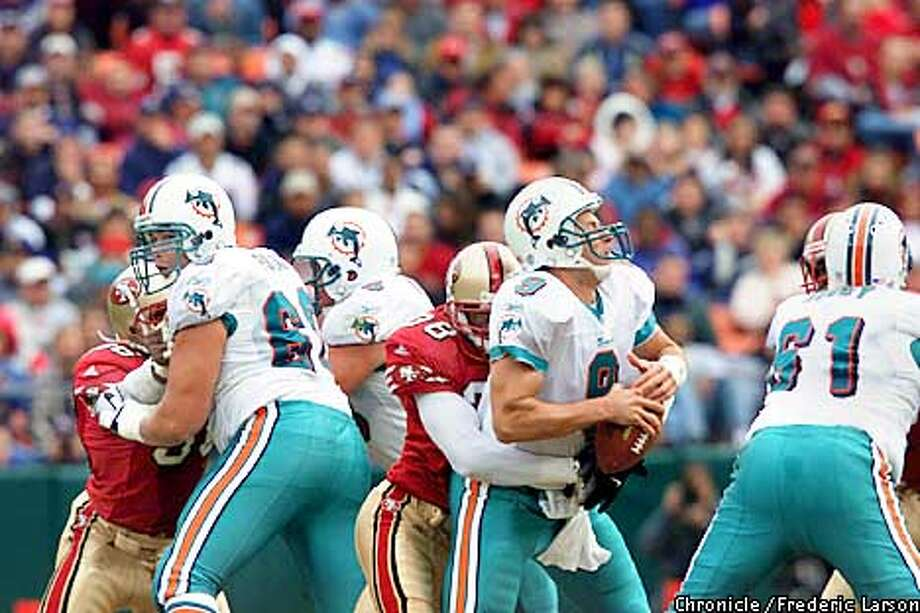 San Francisco 49ers vs. Miami Dolphins. Second quarter action. Jay Fiedler #9, QB for the Dolphins, gets sacked by Ronnie Heard #38 of the 49ers.  Chronicle Photo by Frederic Larson Photo: FREDERIC LARSON